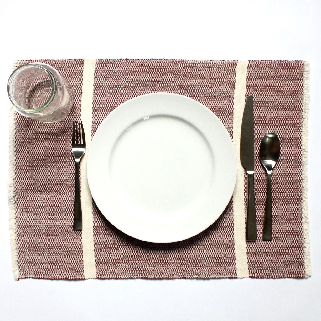 Four 100% eco-dyed cotton maroon placemats handwoven on traditional looms by Living Threads Co. Nicaraguan artisan.