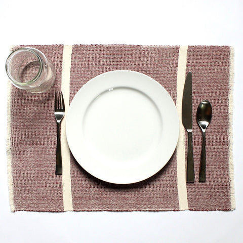 INDI maroon and natural striped placemats woven by hand with 100% ecologically dyed cotton by Living Threads Co.