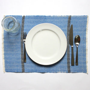 100% eco-dyed royal blue placemats handwoven by Nicaraguan artisans with Living Threads Co.