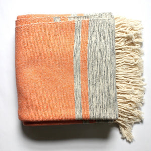 Living Threads Co. MIRA Tangerine Handwoven cotton queen bed blanket created by Nicaraguan partner artisans.