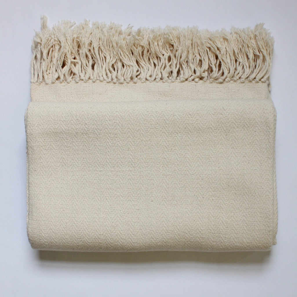 "DANELIA Herringbone Blanket in ""natural"" - naturally dyed cotton handwoven by artisans in Nicaragua by Living Threads Co."