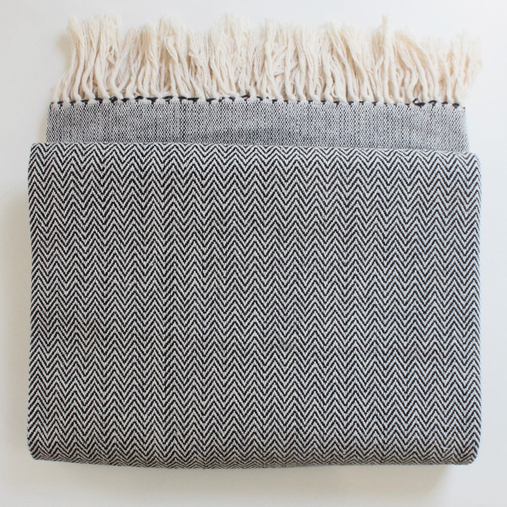 DANELIA Herringbone Blanket cotton handwoven by artisans in Nicaragua by Living Threads Co. in black