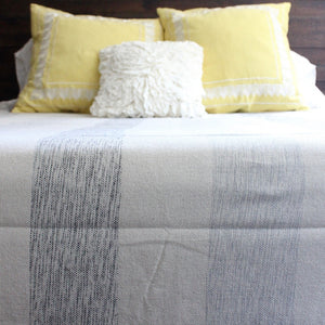 IAM Handwoven cotton queen bed blanket in mixed grey stripe, created by Living Threads Co. artisans in Nicaragua.