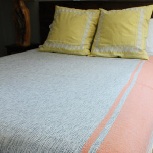 Handwoven MIRA cotton queen bed blanket in Tangerine created by Living Threads Co. artisans in Nicaragua