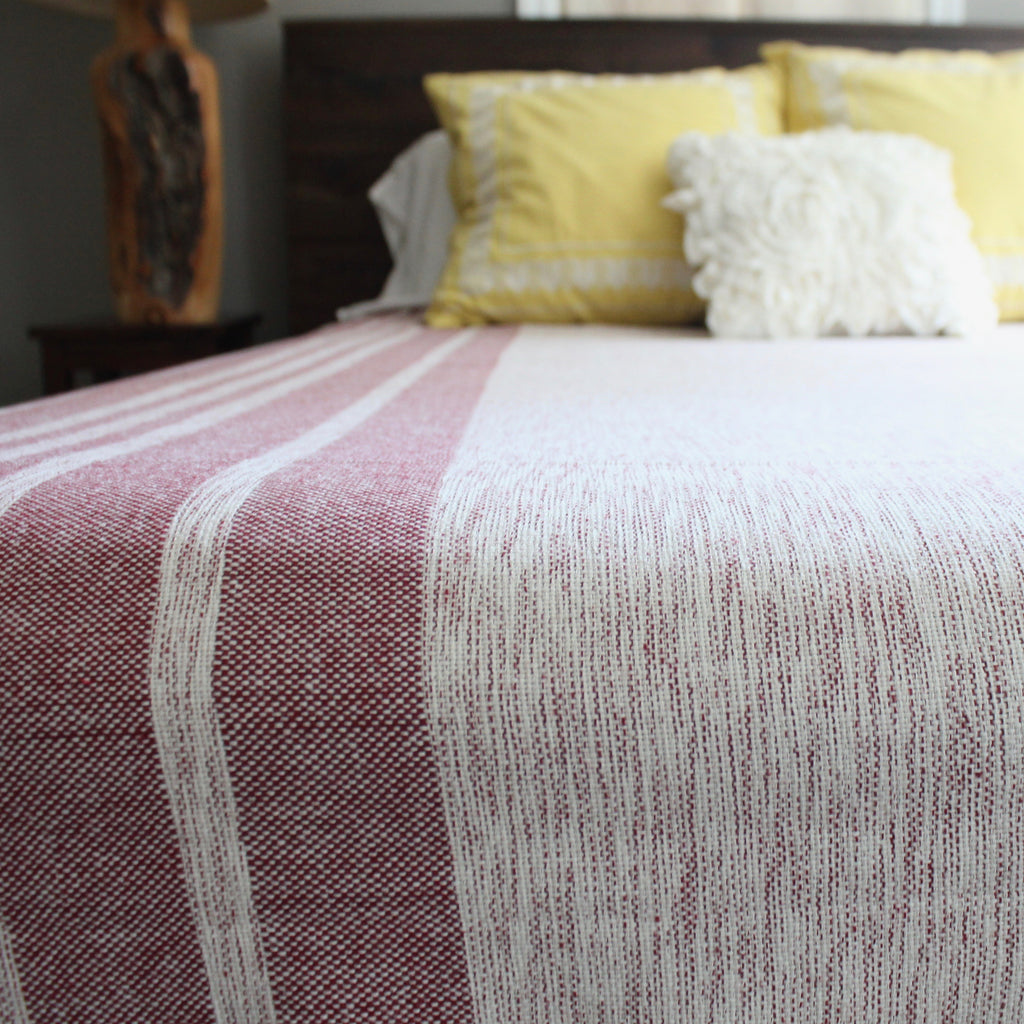 MIRA Handwoven cotton queen bed blanket created by Living Threads Co. artisans in Nicaragua in Maroon