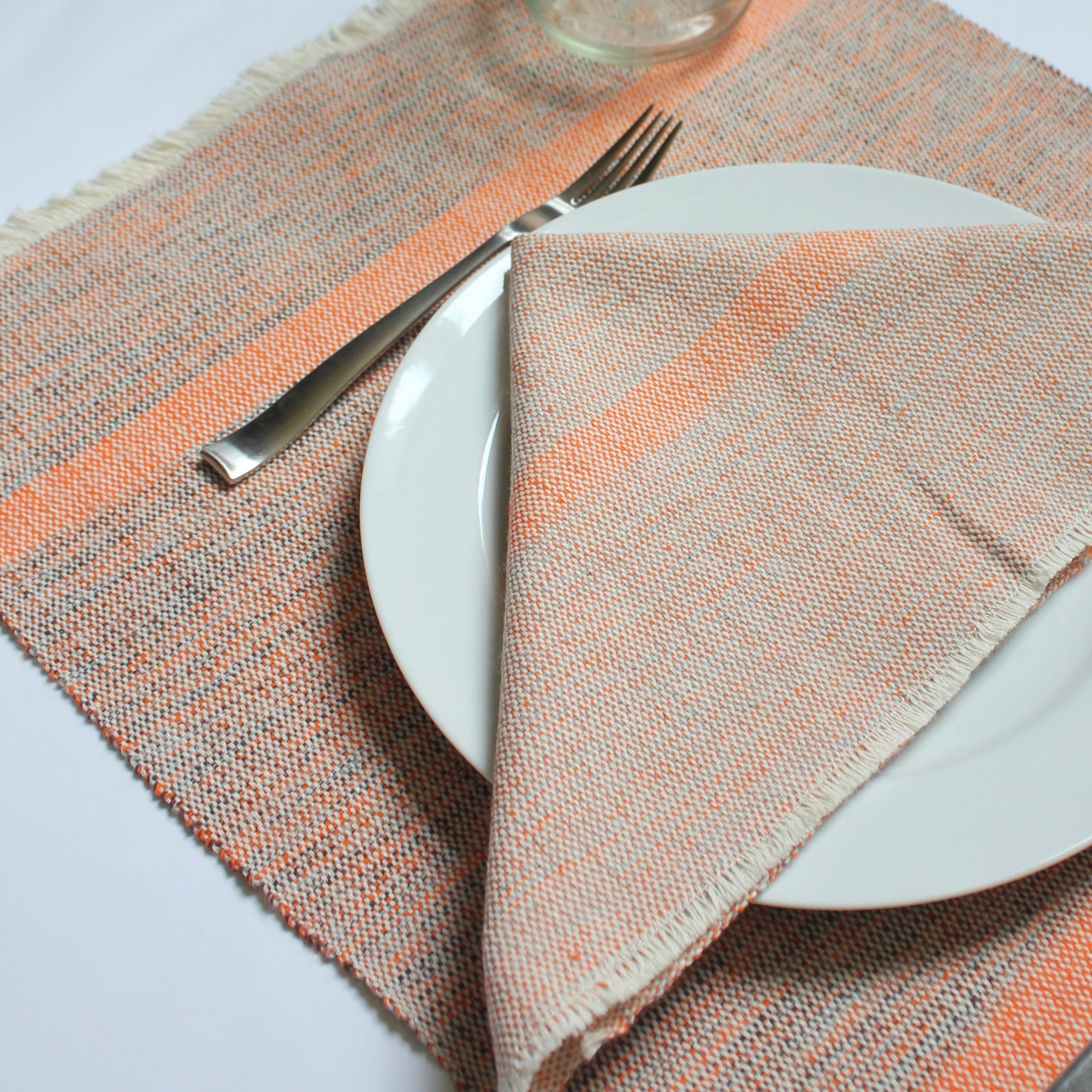 INDI placemats hand woven by Living Threads Co. partner artisans