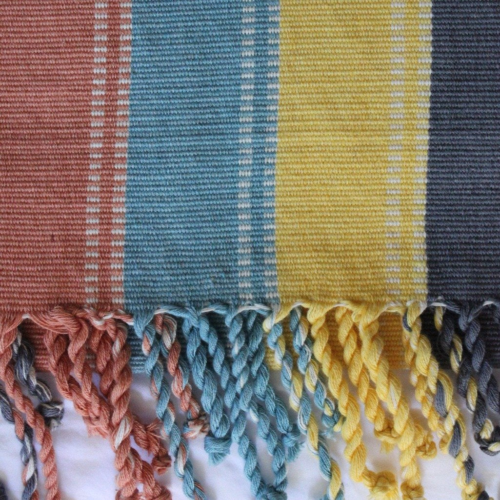 Handmade organic cotton blanket / throw naturally dyed and handwoven on backstop loom in Guatemala by Living Threads Co. artisans