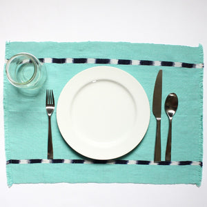 IKAT placemats handwoven on mayan backstrap looms in Guatemala by Living Threads Co. artisans in Turquoise