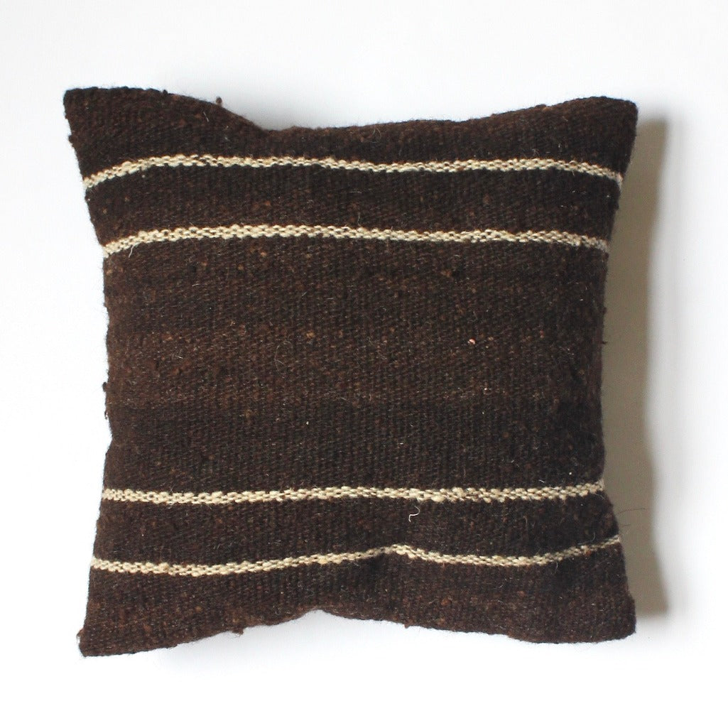 LANA 100% wool pillow in dark brown by Living Threads Co. artisans in Guatemala.