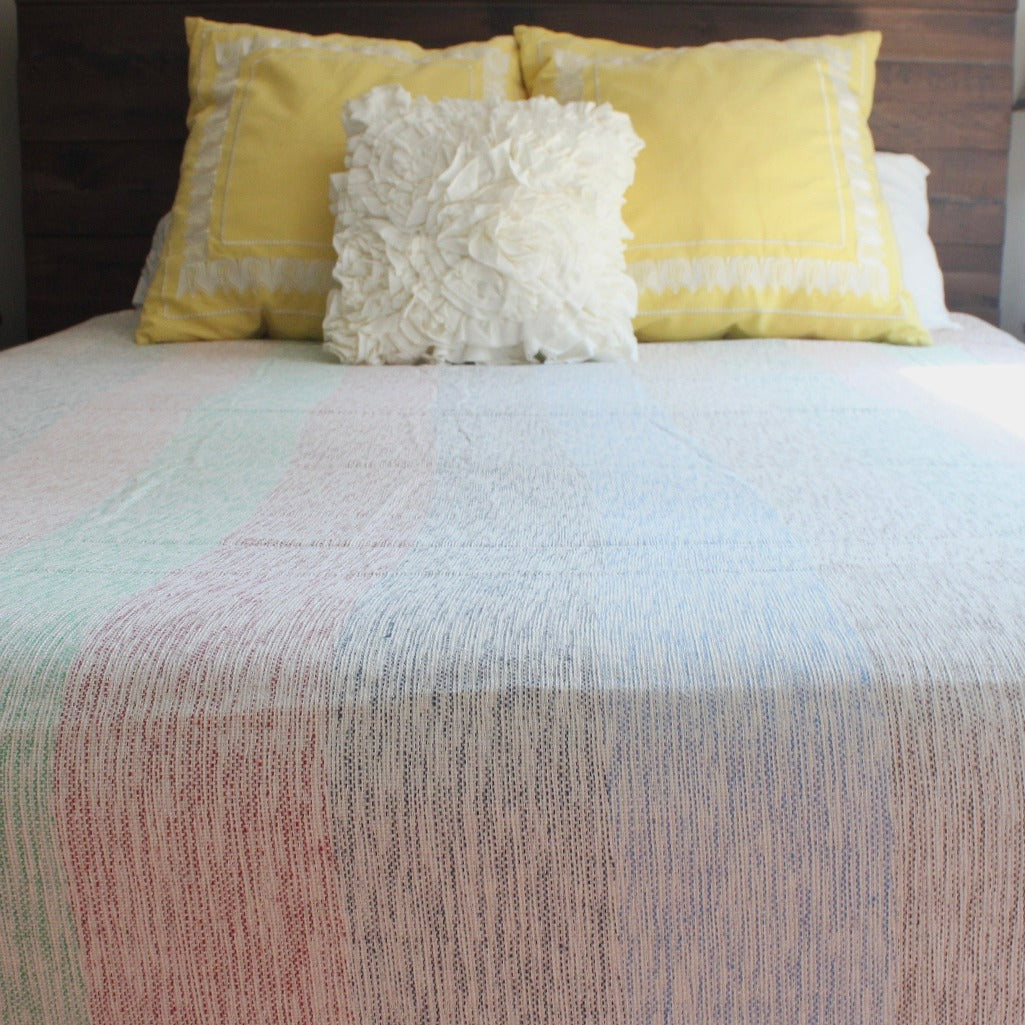 IAM queen blanket in multicolor striped cotton, handwoven by Living Threads Co. artisans in Nicaragua.