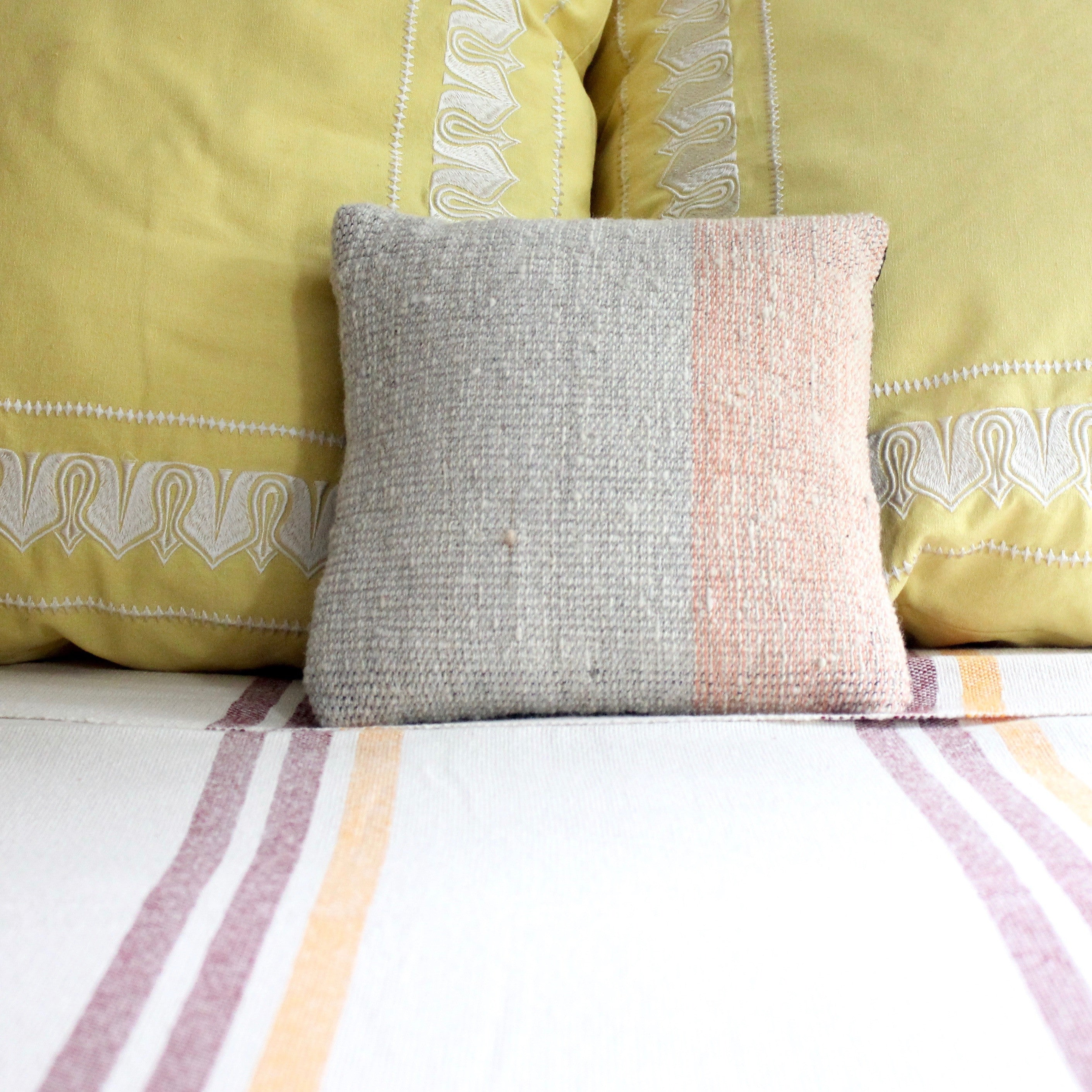 handwoven wool pillow by Living Threads Co. artisans
