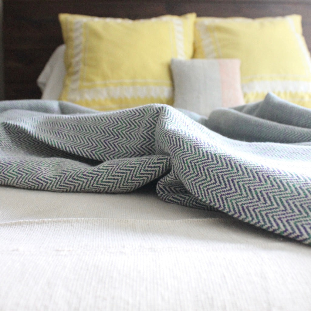 LIA hand woven herringbone cotton throw in purple and Green by Living Threads Co. artisans