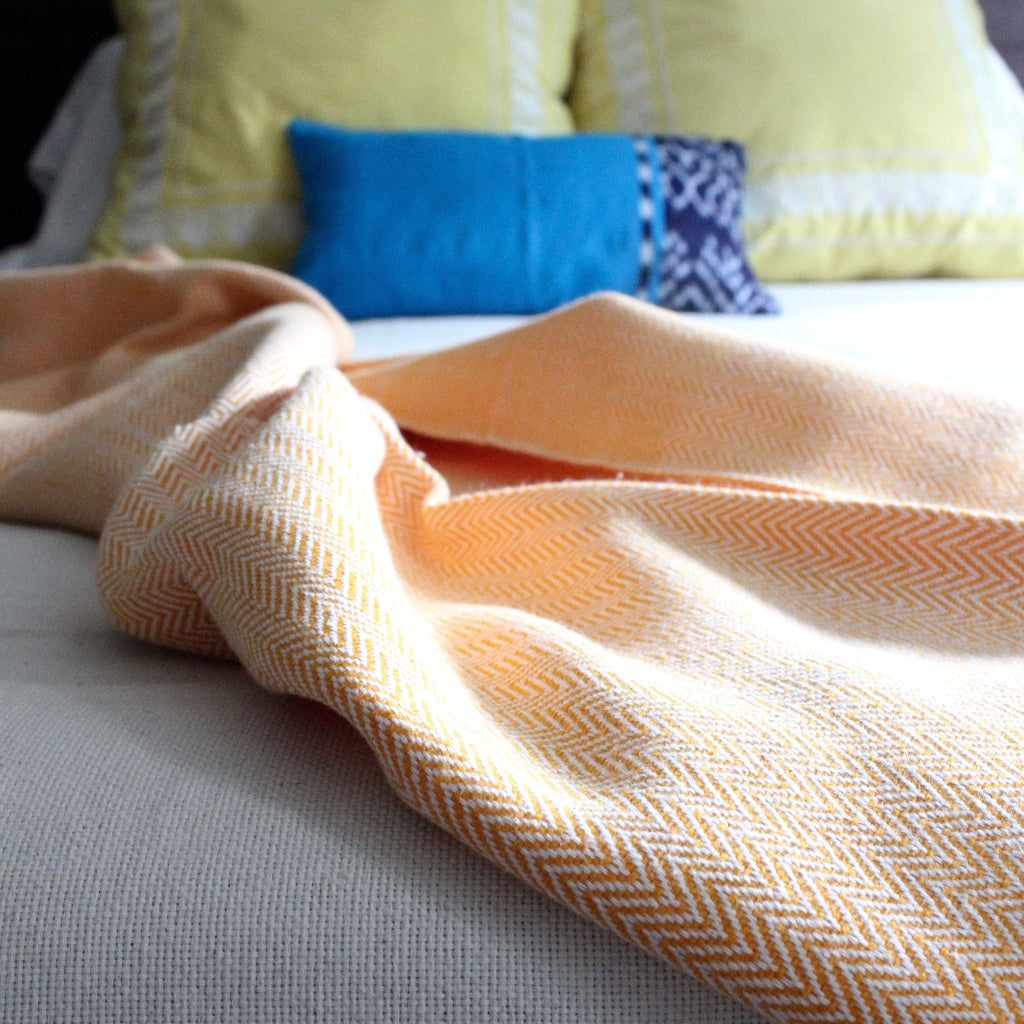 DANELIA Herringbone Blanket cotton handwoven by artisans in Nicaragua by Living Threads Co. in Tangerine