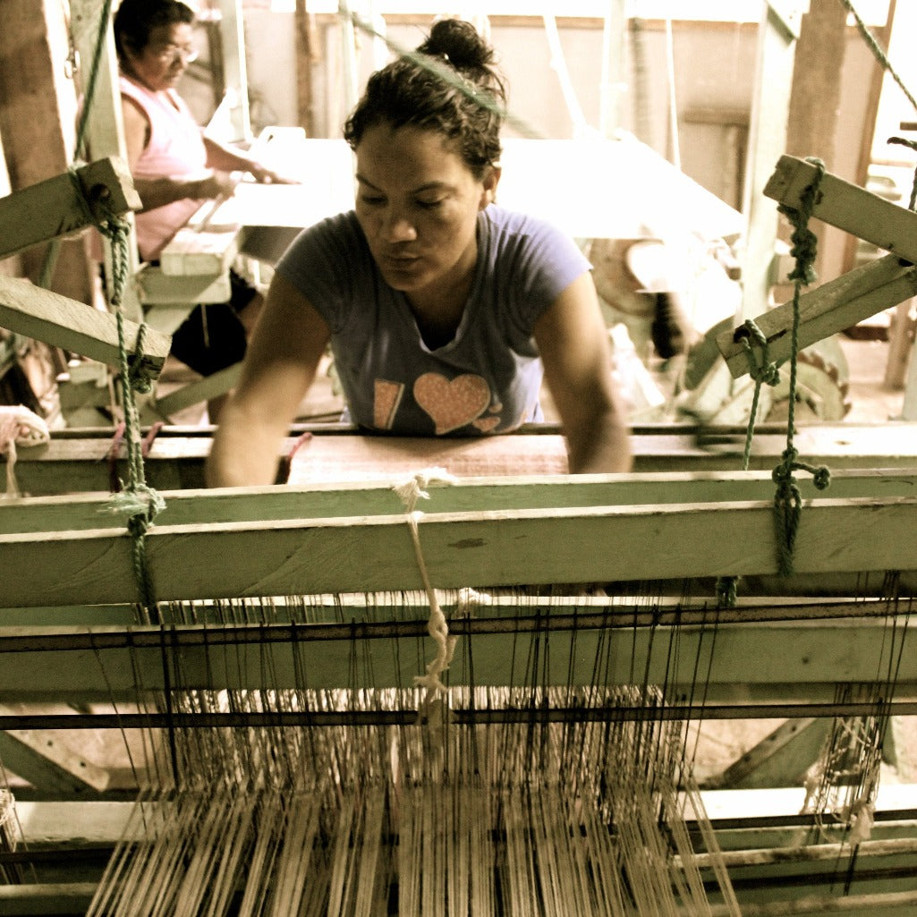 Living Threads Co artisan in Nicaragua working on handwoven cotton table runners