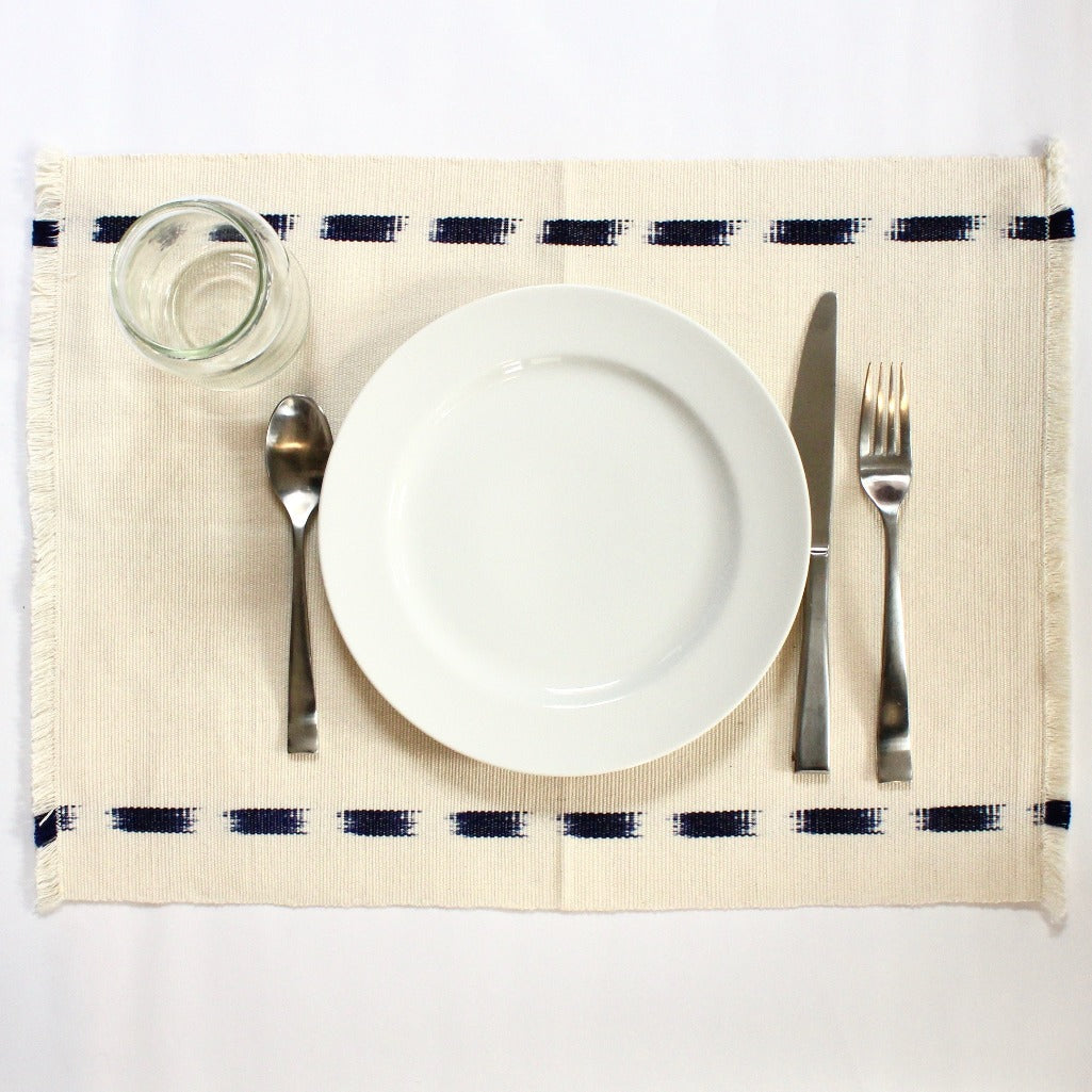 Ikat Handwoven placemats in Natural handcrafted and naturally dyed by Living Threads Co. artisans in Guatemala