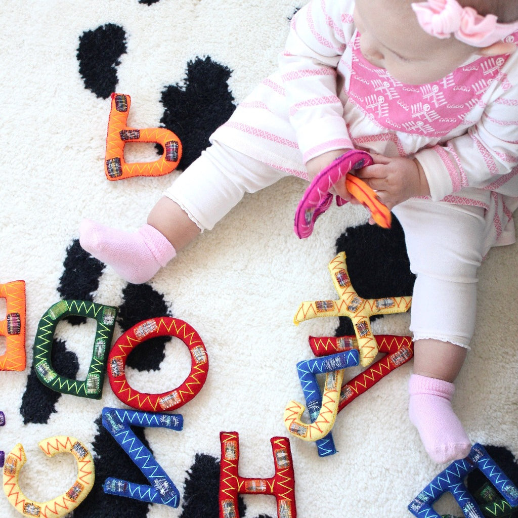Hand Stitched alphabet sets by Living Threads Co. artisans for baby and children