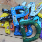 Hand-stitched and embroidered alphabet letters by Living Threads Co.