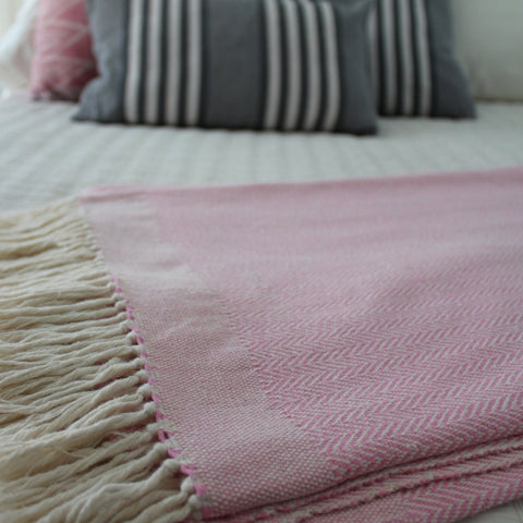 Blush herringbone blanket woven by artisans in Nicaragua by Living Threads Co.