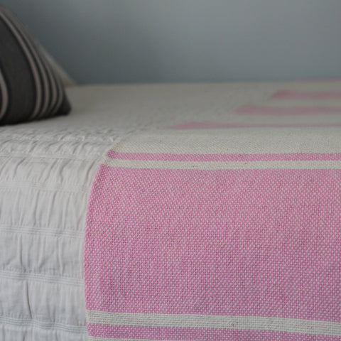 Handwoven AUDAZ 100% cotton blanket by Living Threads Co. in Pink