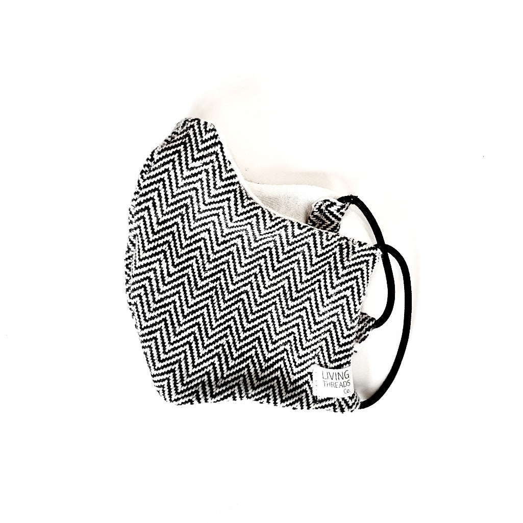 Black-and-white handcrafted artisan woven face masks made with 100% ecologically dyed cotton.