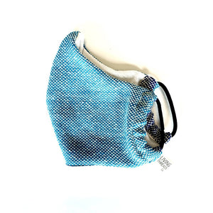 Washable, reusable cotton face mask in bright blue. Made in collaboration with artisans in Nicaragua.