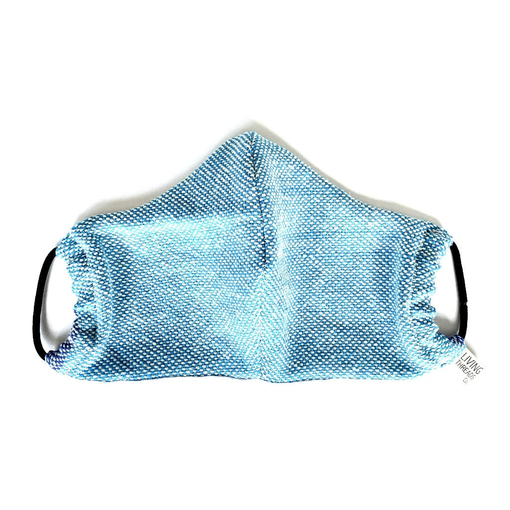 Reusable cotton face mask made in collaboration with partner artisans in Nicaragua.