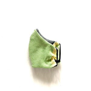 Vibrant green face mask, handwoven by artisans in Nicaragua. Comfortable, washable cotton.