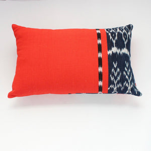 Handwoven 100% organically dyed rectangular throw pillow in bright orange handwoven cotton by Living Threads Co. artisans in Guatemala in a traditional Ikat design.