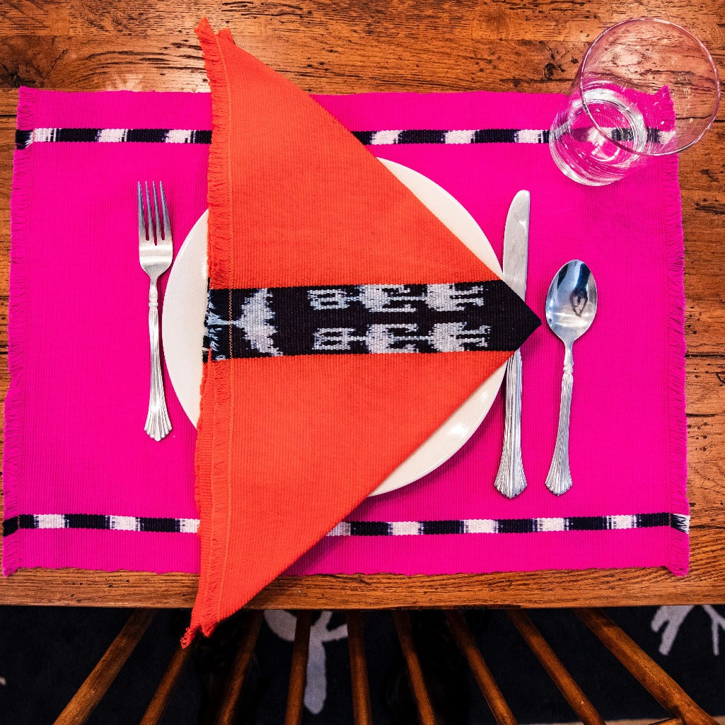 Pink KAT Living Threads Co. handwoven placemats in naturally dyed cotton woven by Guatemalan artisans.