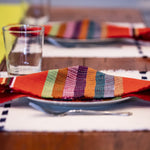 Navy Kus Napkins by Living Threads Co. artisans handwoven natural dye in achiote orange
