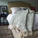 Handmade cotton mixed birdseye throw handmade by Living Threads Co. artisans in Nicaragua in Forest & Natural