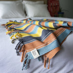 Naturally dyed eco cotton handcrafted throw blanket by Living Threads Co. artisans in Guatemala