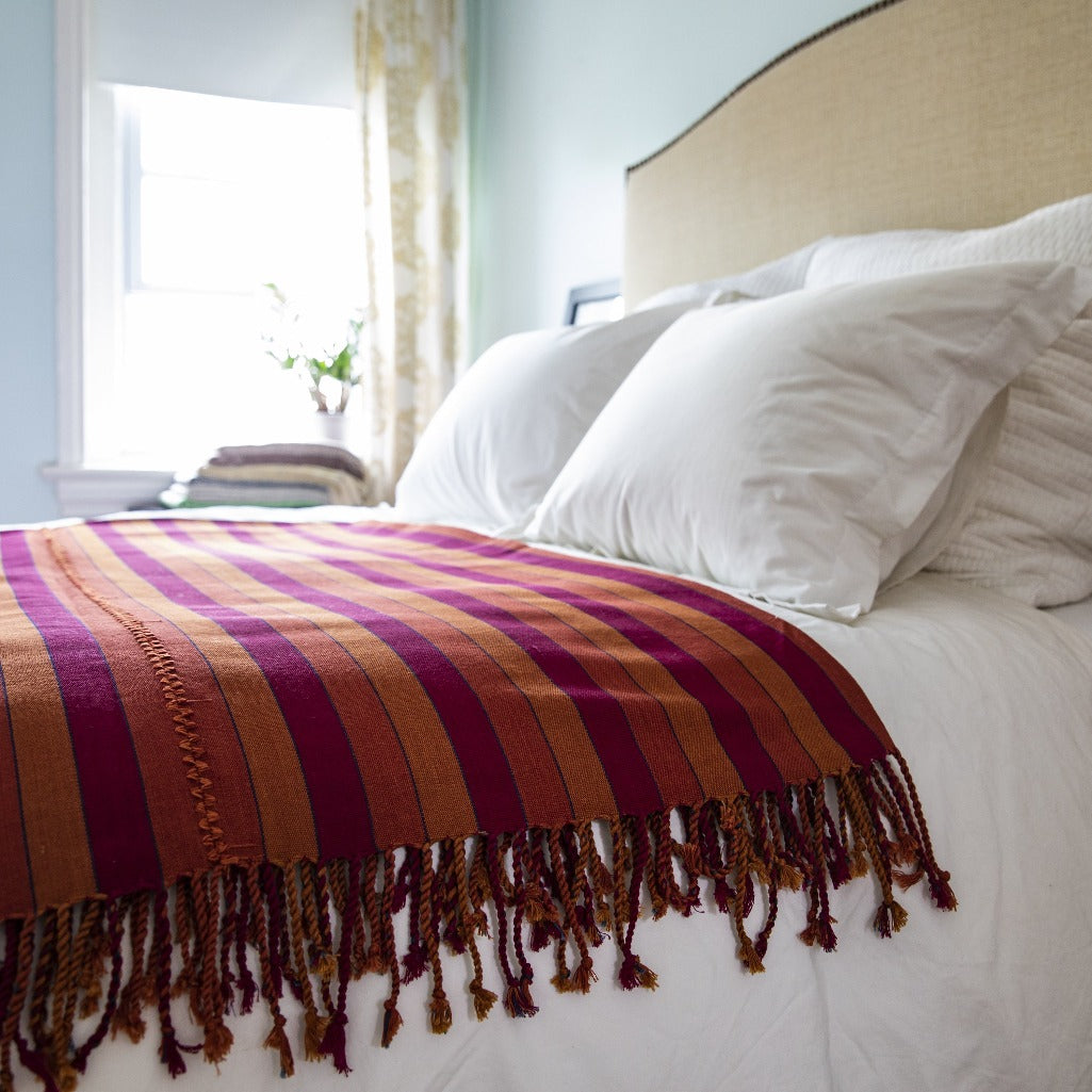 Handcrafted artisanal natural dye backstrap loom woven blanket by Living Threads Co