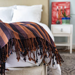 Handcrafted artisanal natural dye backstrap loom woven blanket by Living Threads Co.