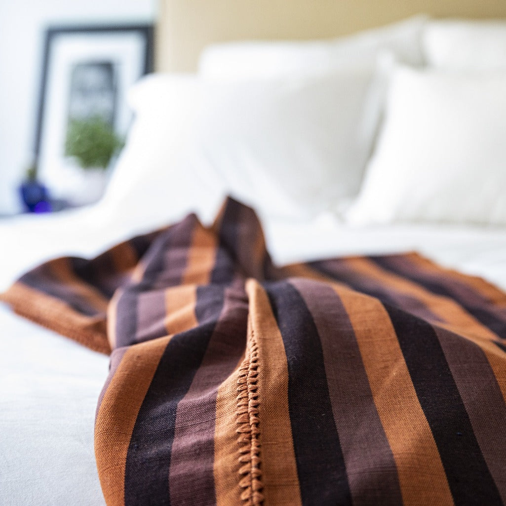 Handcrafted naturally dyed woven blanket by Living Threads Co artisans on a backstrap loom.