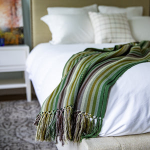 Living Threads Co. handcrafted throws made with naturally dyed Ceiba silk and crafted by Guatemalan artisans.