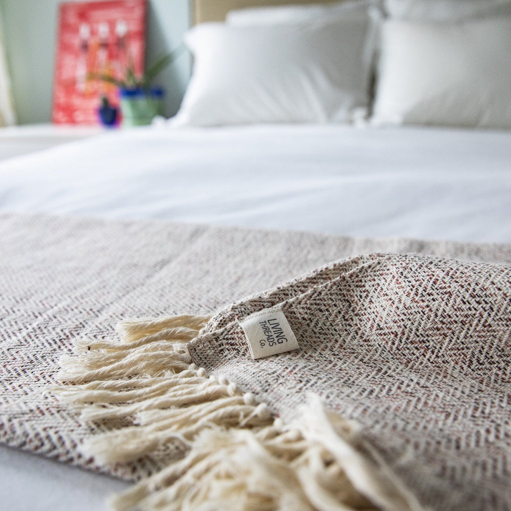 Handcrafted herringbone cotton blanket and throw in tierra handcrafted by Living Threads Co. artisans in Nicaragua