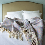 Handmade cotton mixed herringbone throw and blanket handmade by Living Threads Co. artisans in Nicaragua in Rainbow
