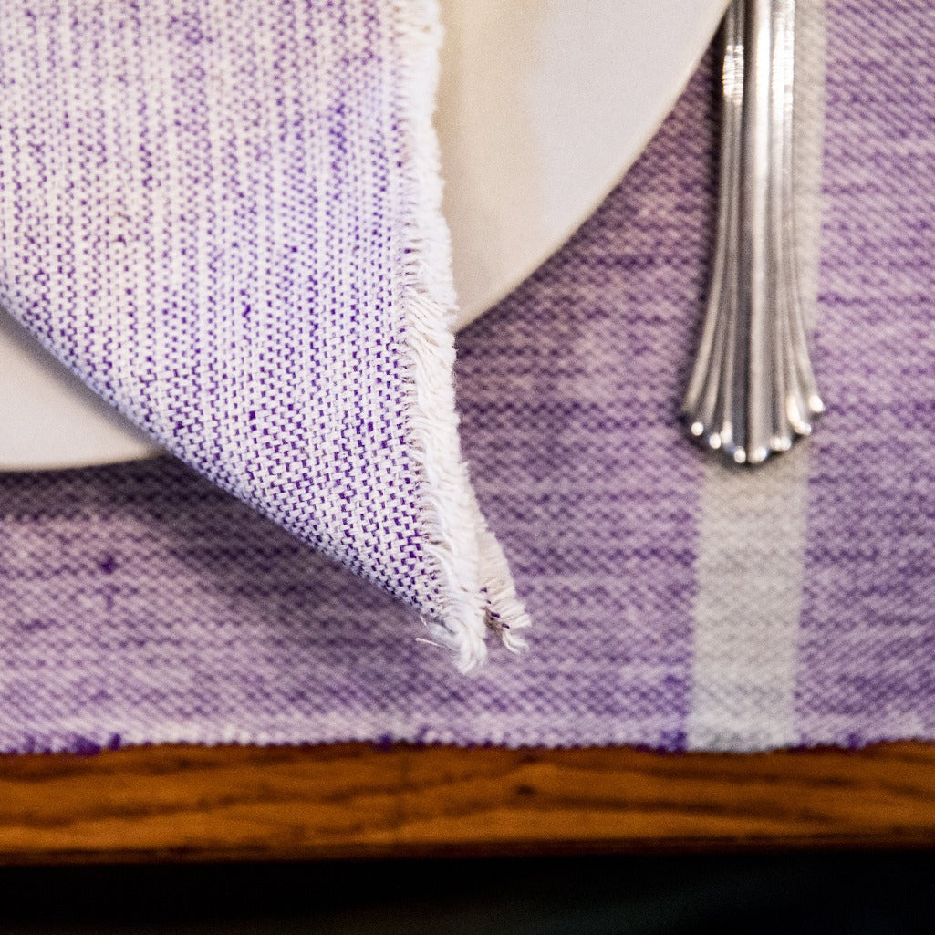 Purple handwoven INDI placemats by Living Threads Co. artisans