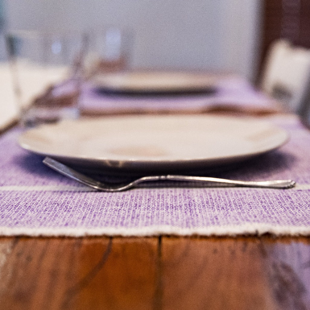 Purple handwoven INDI placemats by Living Threads Co. artisans in Nicaragua.