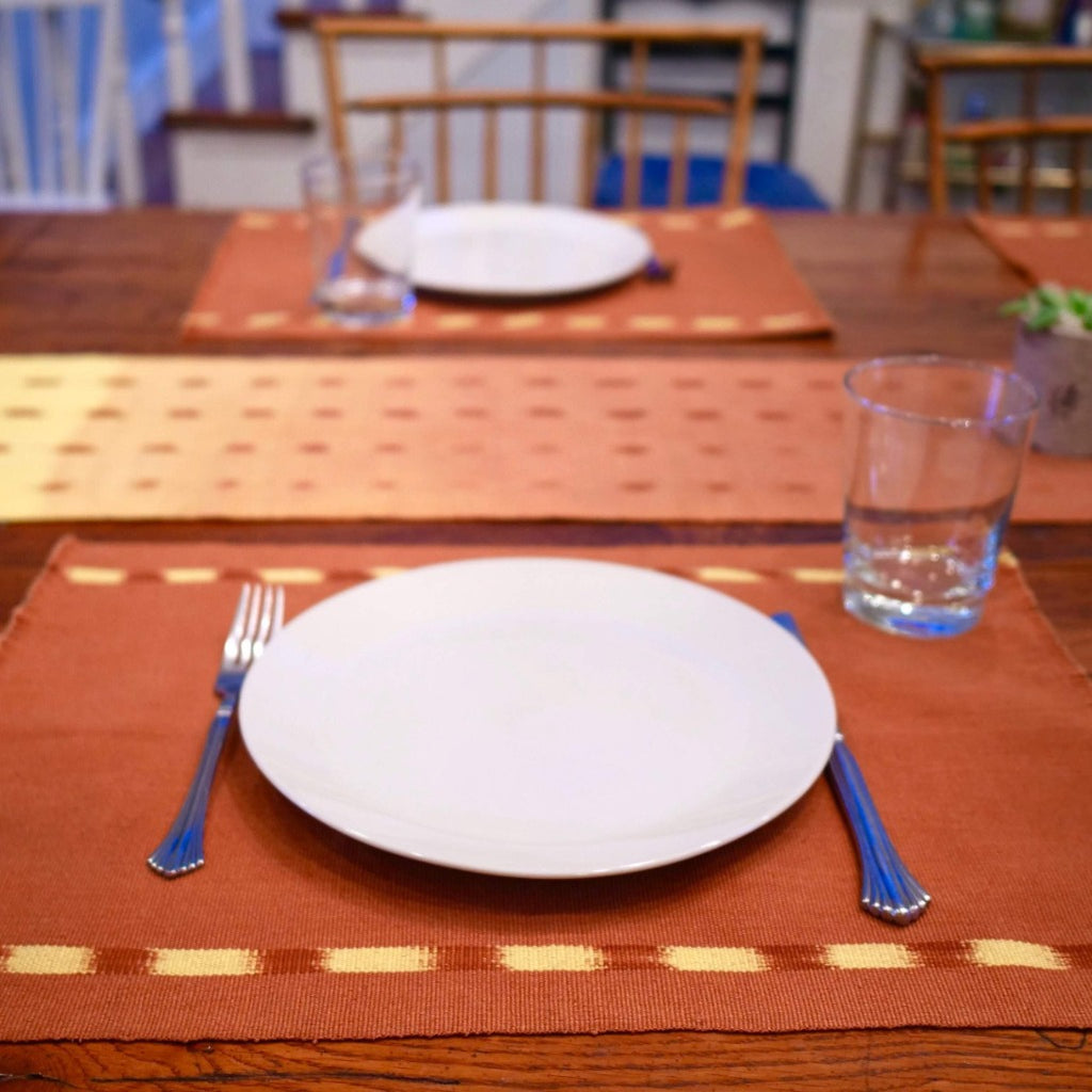 Brown KAT placemats handwoven by skilled artisans in Guatemala.