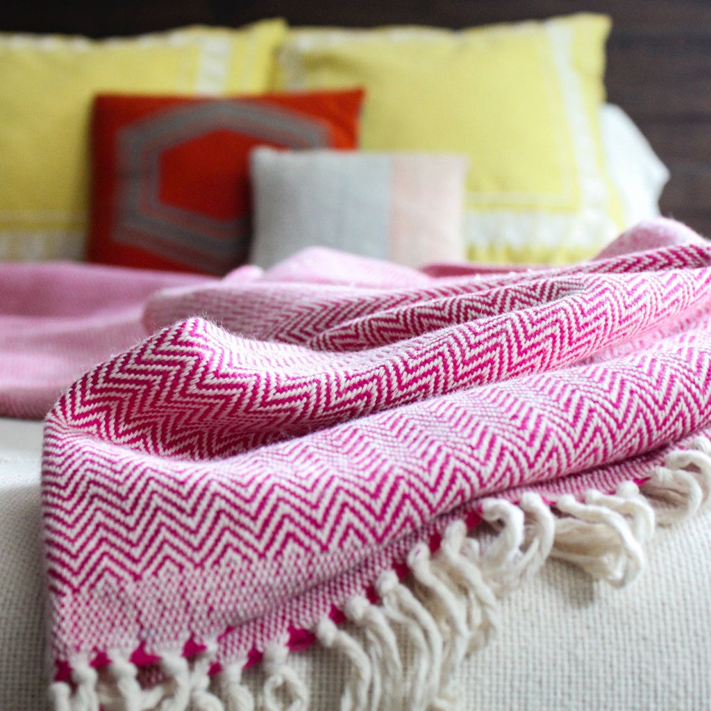 Fuchsia hand woven herringbone artisanal cotton blanket by Living Threads Co.