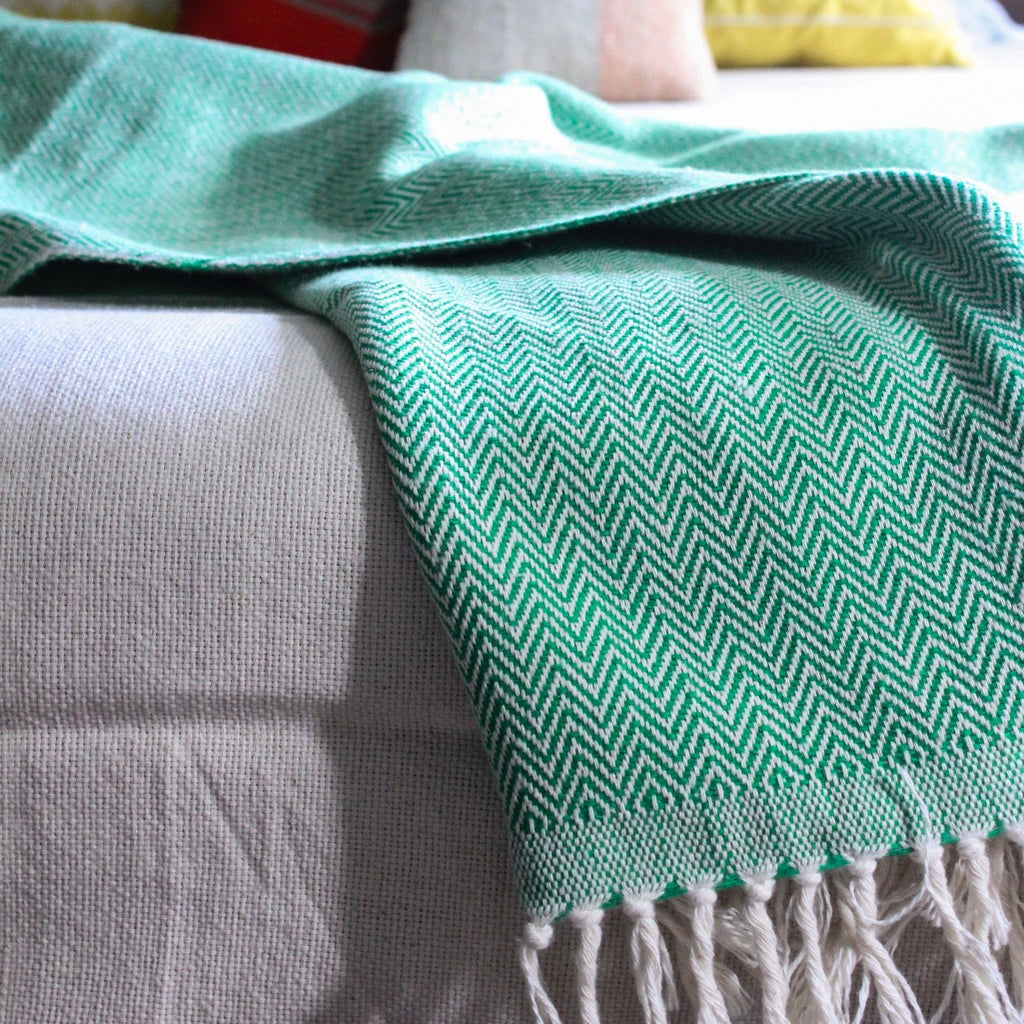 DANELIA Handcrafted Herringbone cotton eco dyed throw balnket. Handwoven by our partner artisans in Nicaragua. Sustainable, mindfully handcrafted for a healthy home.
