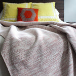 Handmade cotton mixed herringbone throw and blanket handmade by Living Threads Co. artisans in Nicaragua in Terra-cotta