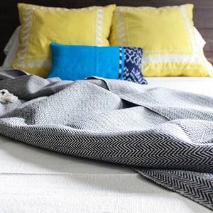 handwoven herringbone 100% ecologically dyed cotton blanket by Living Threads Co. artisans in black