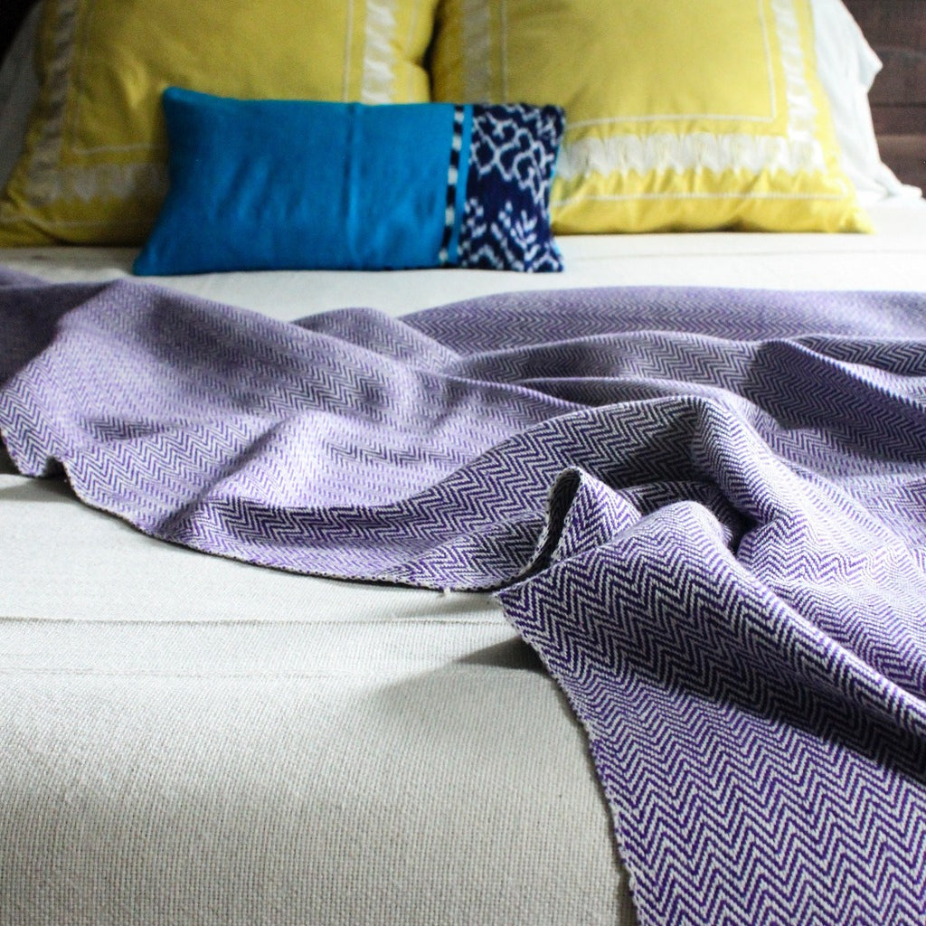 herringbone 100% ecologically dyed cotton blanket by Living Threads Co. in purple