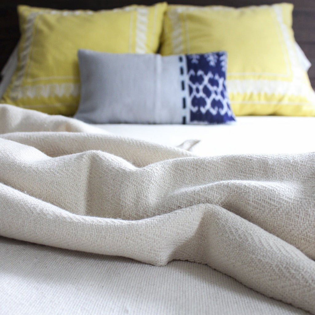 Hand woven artisanal herringbone blanket in natural by Living Threads Co.