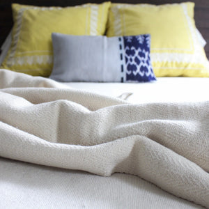 Extremely soft handwoven artisanal herringbone blanket in natural by Living Threads Co.