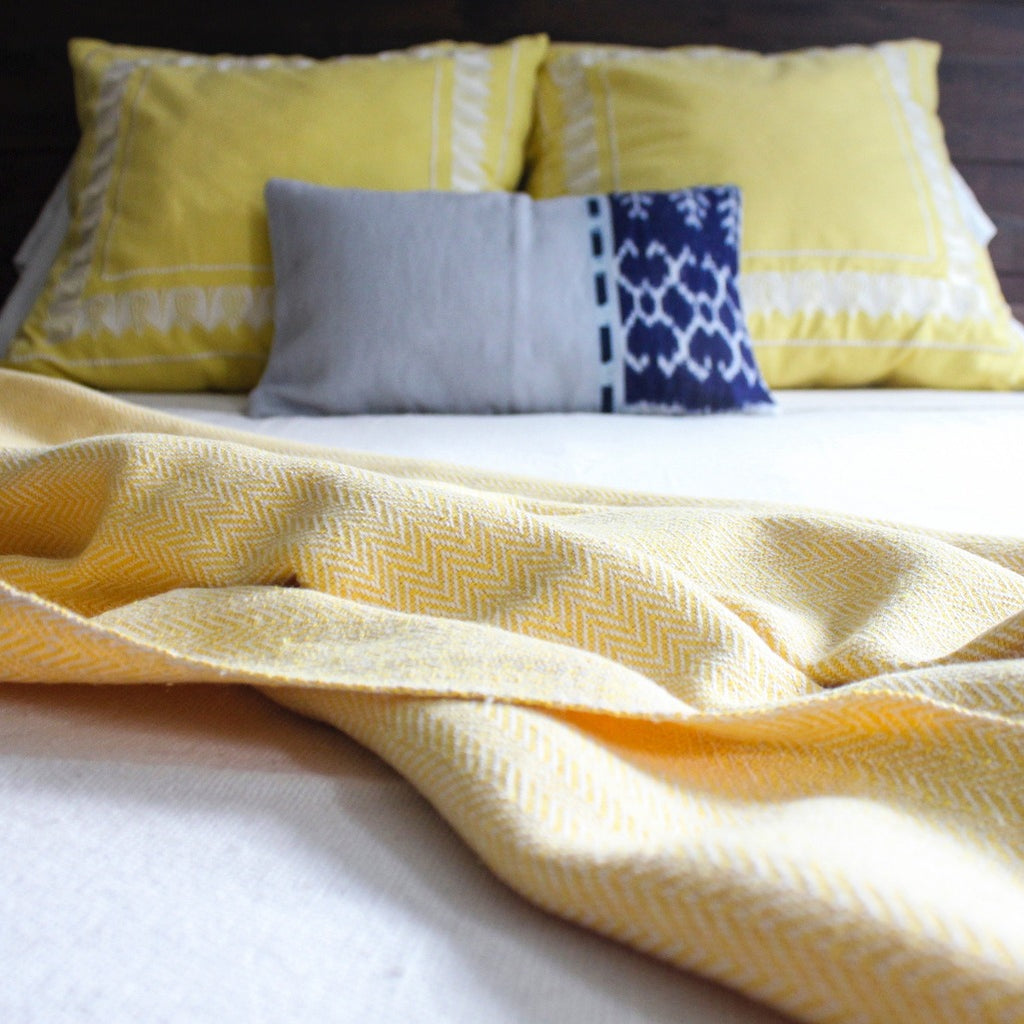 Herringbone 100%blanket by Living Threads Co. in 100% ecologically dyed yellow cotton.