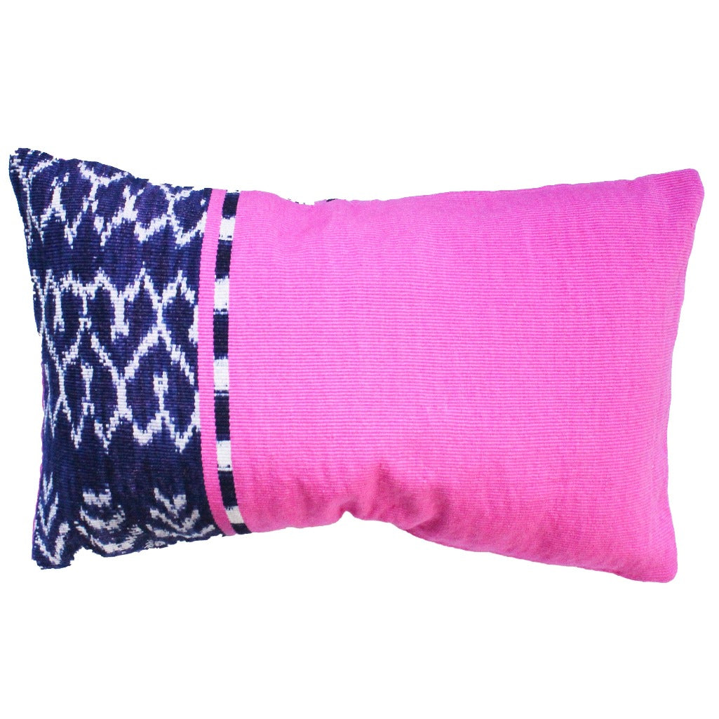 REC Pink Living Threads Co. pillow case in 100% naturally dyed cotton and a traditional Ikat design made by Guatemalan artisans.